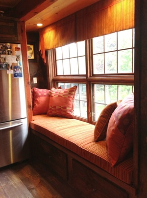 Orange and Red Throw Pillows on Cozy Window Seat - Pillows and Sensational Seams